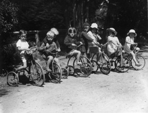 Group of children on tricycles