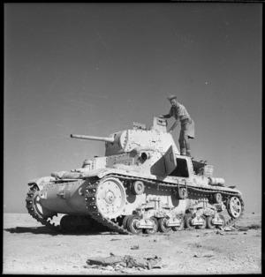 New Zealand soldier examining an Italian tank, Egypt, during World War 2