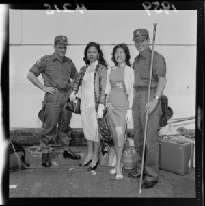 Two soldiers with their Malayan wives at Glasgow Wharf, Wellington on the return of the New Zealand Army from Malaya