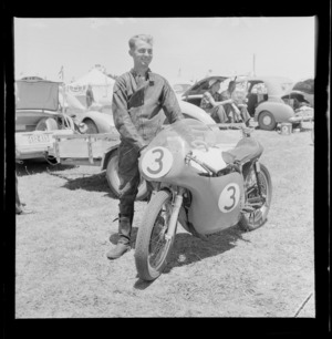 Unidentified race member with his racing bike, at the New Zealand Grand Prix, Ardmore Airport, Manukau, Auckland