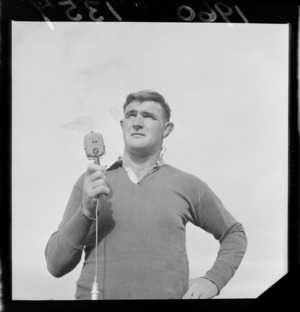 All Black No.8 Peter Jones in rugby gear standing on Athletic Park Rugby Grounds with a microphone, Wellington City