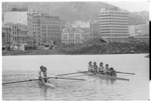 Boating club members, Wellington Harbour, with public works site on the shore behind