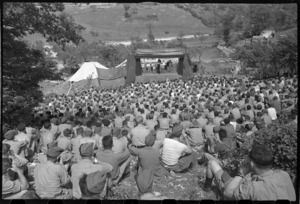 World War 2 New Zealand troops watching the Kiwi Concert Party's first concert in Italy, Volturno Valley, Italy