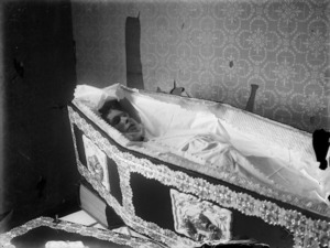 Open coffin and unidentified body