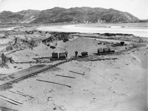 Sandhills alongside Lyall Bay, Wellington, with railway track and wagons