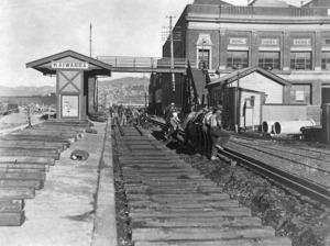 At Kaiwharawhara railway station, shows workers