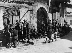 2nd NZEF soldiers resting in a village street in Crete