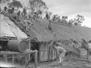 Soldiers of the 2nd NZEF IP thatching a newly built mess in New Caledonia