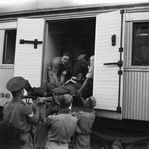 Repatriated prisoner of war being lifted on to the ambulance train at Alexandria, Egypt