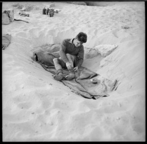 New Zealand World War 2 soldier in typical sleeping conditions in the Western Desert, North Africa