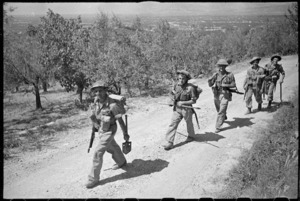 New Zealand infantry moving along the road towards Florence, Italy
