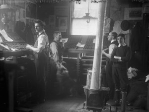 Young men alongside type trays, in the printing office of the Opunake Times newspaper, Opunake