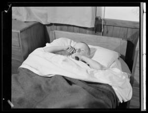 An unidentified boy in bed, Polish children's refugee camp, Pahiatua