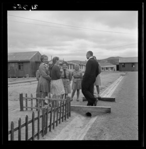 Father Wilniewczyc talks to a group of girls at a Polish refugee camp, Pahiatua