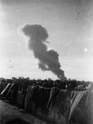 Air force raid on Benghazi Harbour, Libya, seen from prison camp 116