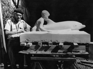 Weigel, William George, 1890-1980 : Russell Clark putting the finishing touches to the statue of Opononi's dolphin Opo