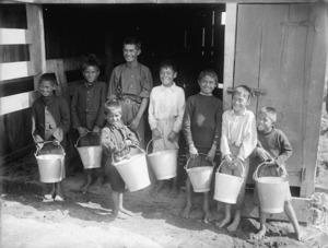 Unidentified Maori children with buckets