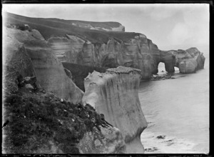 Cliffs and rock arches forming a natural bridge at Tunnel Beach, ca 2 km west of St Clair, Dunedin.