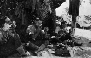 World War 1 soldiers Charley Fitton, Bunkall and A F Buckland of 11th Squadron, Auckland Mounted Rifles, shaving under palms at Bir-Et-Maler, Palestine