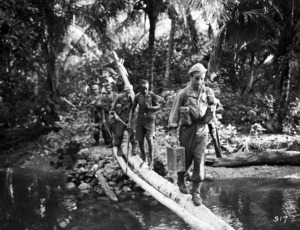 Soldiers crossing a river in the Pacific Region during World War II