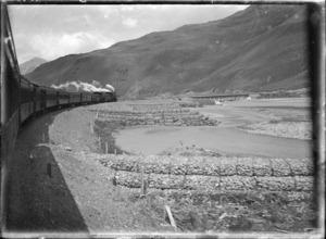 Otira to Christchurch Express train on a bend alongside the Waimakariri River.