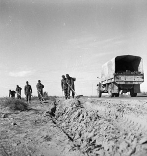Paton, H fl 1942 (Photographer) : New Zealand Engineers search for German and Italian mines on the roadside in Tripoli, Libya, during the 8th Army advance