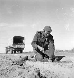 Paton, H fl 1942 (Photographer) : New Zealand engineer extracting mines in Tripoli, Libya
