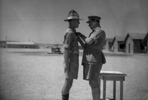 Major General L M Inglis presenting the Distinguished Conduct Medal to W J Smith at the New Zealand School of Instruction, Maadi, Egypt