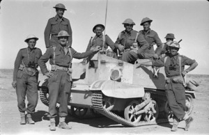 Members of a World War 2, North Island Battalion reconnaissance party, alongside a Bren carrier, in Libya