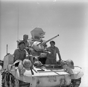 Soldiers of the New Zealand Divisional Cavalry on a tank at El Alamein, Egypt - Photograph taken by H Paton
