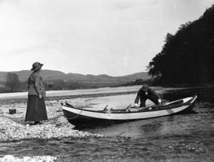 Man and woman with rowboat, Tongariro River
