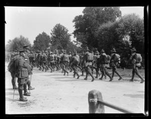 New Zealand troops on a route march being inspected by General Godley