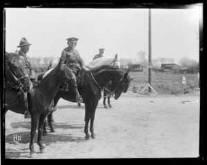 The Commander of the New Zealand Division inspects a New Zealand brigade on its return from training.