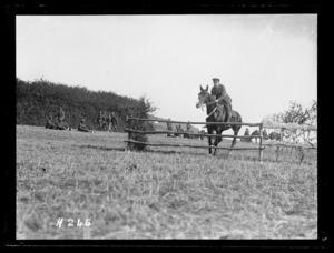 A horse and rider prepare to jump at the Anzac Horse Show, World War I