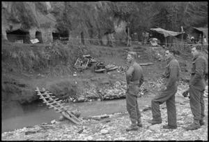 New Zealand soldiers surveying caves used as living quarters by Cassino civilians, Italy, during World War 2