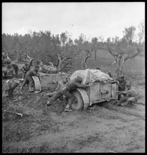 New Zealand artillerymen manhandling guns in heavy mud on the Sangro River front - Photograph taken by George Kaye