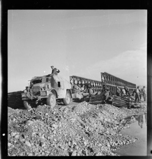 Tractor and gun of New Zealand Artillery crossing a newly finished bridge over the Sangro River, Italy, during World War II - Photograph taken by George Kaye