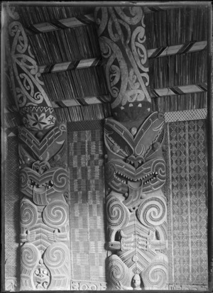 Carved panels and tukutuku panels in the Maori meeting house at Parawai, Thames, in 1917