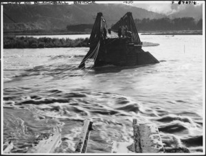 Remains of the road and rail bridge at Blackball, West Coast, over the flooded Grey River - Photograph taken by L A Inkster