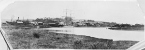 View of Helensville and the river. Ships SS Aotea, and Hazel Craig moored at the wharf.