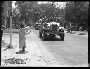New Zealand trucks passing through Maadi, Egypt, during World War 2 - Photograph taken by H Paton