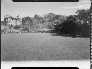View of house and tennis court across large lawn, Homewood, Karori, Wellington