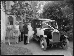 Wedding party with bride stepping into automobile, Black and White wedding of Mary Garden