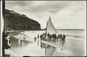 Beach scene, Sumner, Christchurch, showing a group around a yacht