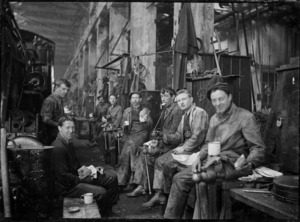 Group of men having a break at a railway workshop, probably Hillside, circa 1926