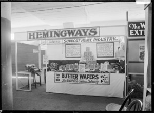 Stall at a trade fair advertising and displaying the produce of J L N Hemingway, including butter wafers and other items associated with ice creams