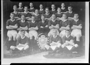 Unidentified rugby team with shield, including R E Diedrich, J R Page, N Ball, O P Price, D E Oliver - Photograph taken by Standish and Preece