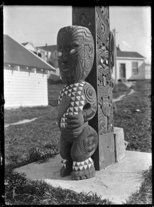 Maori carved figure at the base of a pillar