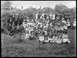 Men, women, and children, at a picnic