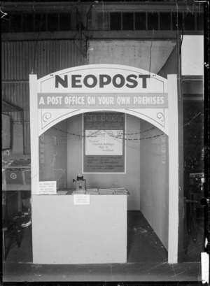 """Stall at a trade fair advertising and displaying Neopost """"A Post office on your own premises"""""""